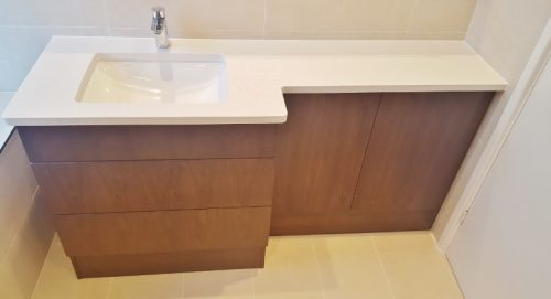 Bathroom cabinet in brown with white basin and worktop