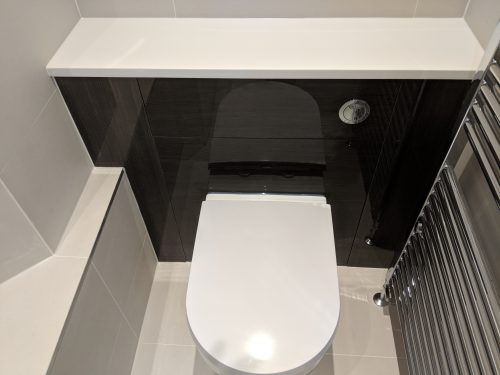 Stunning glossy finish dark unit and light tiling