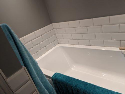 White Metro tiling with white bath