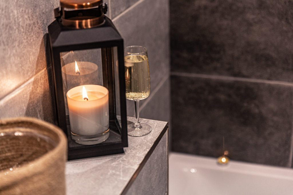 Bathroom with candles and wine