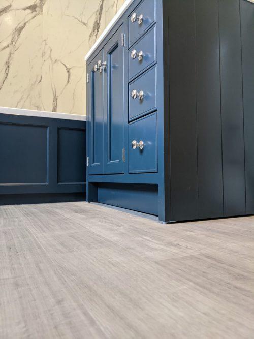 Laminate flooring and blue bathroom units