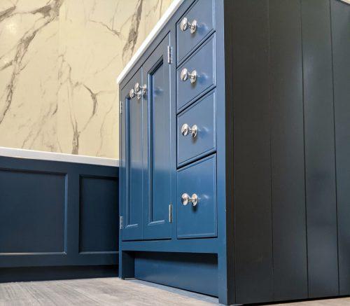 Blue bathroom units with blue bath panel