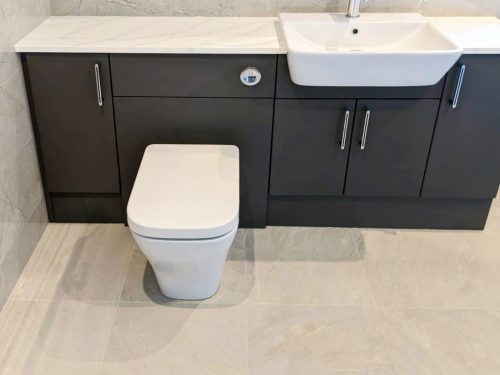 Dark units with white marble worktop